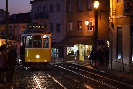 Yellow trolley car down the street at sunset Stok Fotoğraf