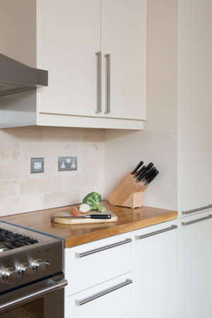 worktops: Fitted kitchen with wood counter tops  wall tiling  food preparation ongoing