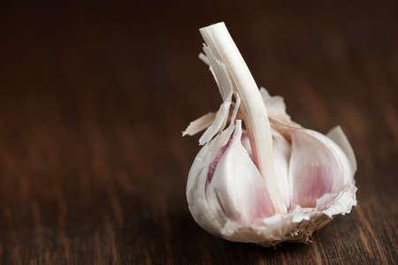 Garlic bulb resting on wood