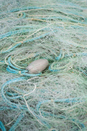 Green and Blue fishing nets with rope  weights photo