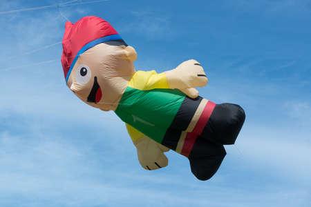 Blyth Northumberland UK: 04 MAY 2015. Large character kite in flight at Blyth Kite Festival 2015
