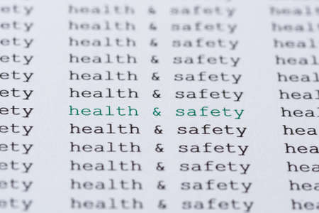 workplace wellness: The phrase health  safety highlighted in green amongst similar black text