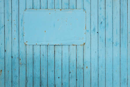 Blank blue sign on blue painted timber board