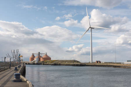 Blyth Northumberland UK: 24 April 2015. Wind turbine silos jetty  sculpture on banks of River Blyth in Northumberlnd England