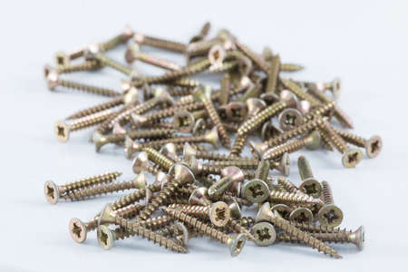 woodscrew: Brass wood screws resting on white surface