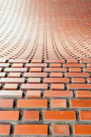 Brickwork masonry arch in flemish bond with shallow depth of focus  background