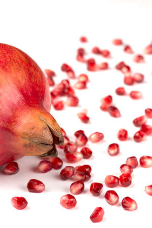 Pomegranate seeds on white background Punica granatum