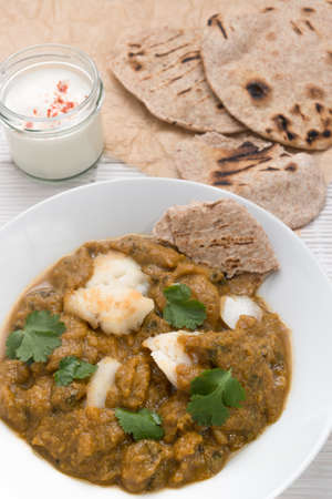 Fish curry meal with chapati flatbread photo