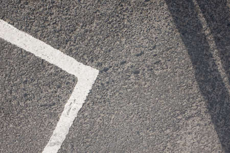 Abstract white line road markings on tarmac road or car park