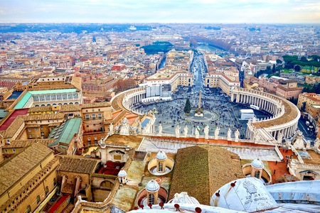 Saint Peters Square in the Vatican and an aerial view of the rooftops of Rome, Italy in a travel and tourism concept