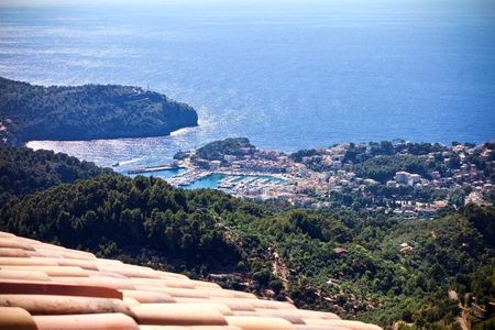 Aerial view of Port de Soller outdoors in a valley with a mediterranean sea in the background