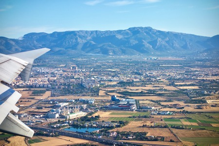 Aerial view from a plane of Mallorca with distant view of mountains