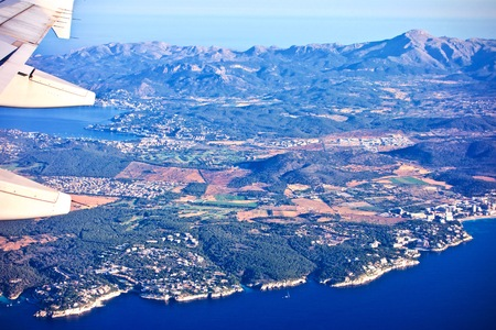 Aerial view from a plane of Mallorca with the mediterranean sea and distant mountains Stok Fotoğraf