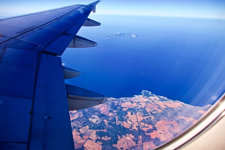 Aerial view from a plane of Mallorca with the mediterranean sea and distant view of Ibiza Stok Fotoğraf