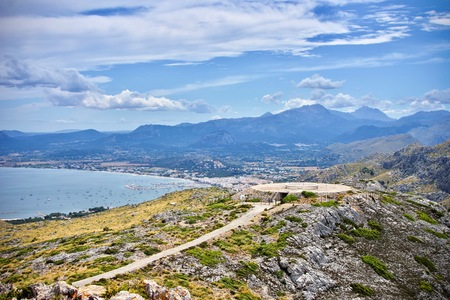 top view from Mirador es Colomer and distant view of montains and a mediterranean sea port Stok Fotoğraf