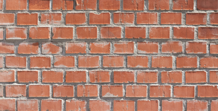 Orange brown brick background with grey grout. Stock Photo
