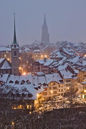 Old town of Bern by night during snow storm.