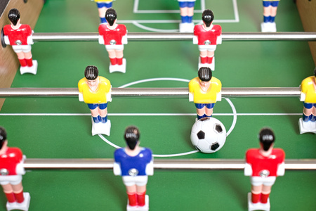 Table football game with yellow, red and blue plastic players. 写真素材