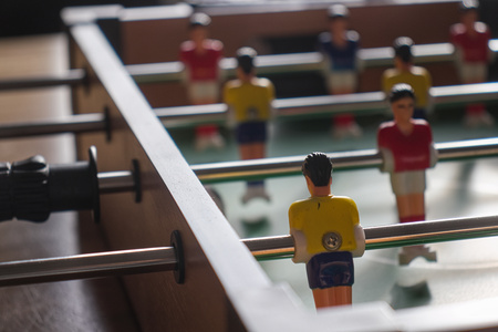 Table football with yellow and red kickers.