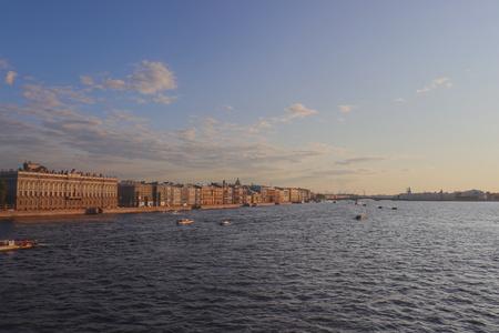 Boats cruising through the Neva river ready to pass the opening bridge. 写真素材