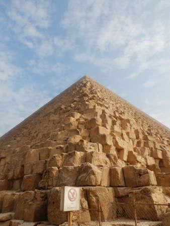 Pyramids of Giza Egypt with no climbing sign.