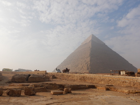 Pyramids of Giza Egypt with car passing by.