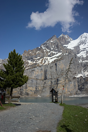 View of pathway at Lake Oeschinen (Oeschinensee) with mountain range in Kandersteg.