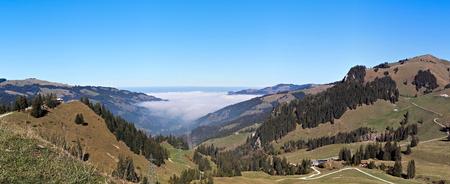 Fog sitting in valley in fribourg, gypsera.
