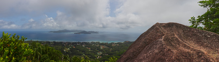 Panoramic view of granite rock and the ocean with the island of praslin. Viewpoint (Nid dAigle) in the seychelles.