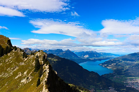 Scenic View of mountains (Niesen) and lake Thun (Thunersee). Interlaken at the end of the Lake.