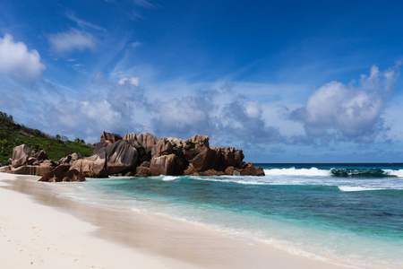 Beautiful turquoise water beach Anse Cocos in the seychelles (La Digue).