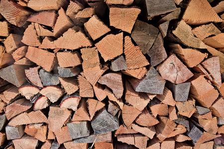 Triangular wooden logs stacked under house. 写真素材