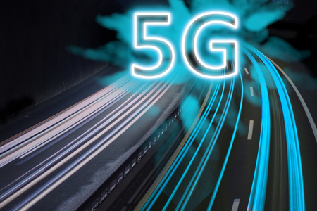5G network wireless systems and internet shown with blue trail lights on highway.
