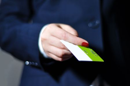 Women hand in blue suite paying with credit card photo