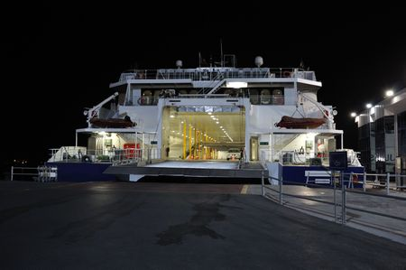 ferryboat: Ferry in port during night.