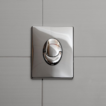 Economic toilet flush knob with two separate buttons. Grey tiles background Stock Photo - 6945243