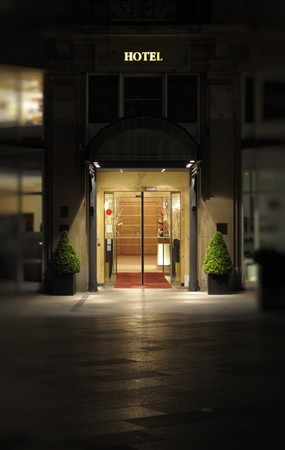 hotel building: Nightshot of the entrance and facade to a luxury hotel. Stock Photo