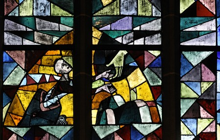 Stained glass in Bremen Cathedral (Bremer Dom or St. Petri Dom zu Bremen). It illustrates a hand of hope. photo