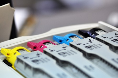 printer paper: This photograph represent 4 inks cartridges of a color printer Stock Photo