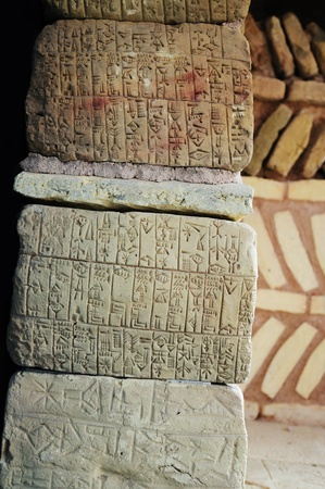looting: Natural stones with ancient Sumerian writing.