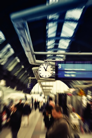 work station: Clock in Train Station Grand Central Station. Frankfurt am Main, Germany. Selected focus on clock. Peoples are blurred.