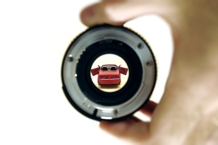 Man looking through a lens to its dream car. Great concept for your brochure, print advertising and other media. Stock Photo - 9045641