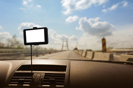 This photograph represents a GPS navigation system on a car dashboard. Useful file for your brochure about security, travel and other transportation services. photo
