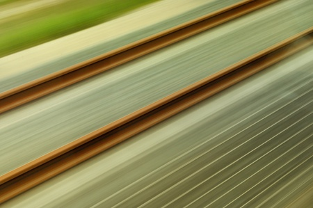 Abstract view from a high-speed train on rail. Useful file for your transportation brochure, annual report and other corporate media Stock Photo - 9616823