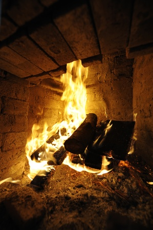 Homely warm log fire. Useful file for your brochure about home, restaurnat and hotel services. photo