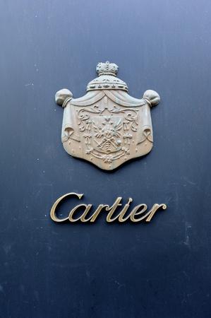 western script: Vienna, Austria - July 05, 2011: The logo on the Cartier boutique store. Vienna, Austria  Editorial