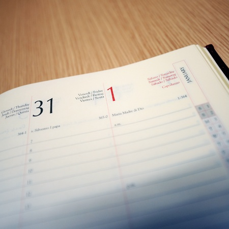 docket: Calendar agendashowing 31 December and 1 January dates.  Shallow depth of field - focus on the dates. Useful file for your brochure about new year celebration. Stock Photo