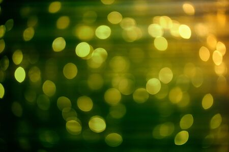Blurred Christmas lights at night. Nice green to yellow color swatch. Useful file for your christmas brochure, flyer, banner or ad. photo