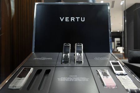highend: Istanbul, Turkey - January 3, 2011: Vertu phones, Nokias high-end line of cell phones, on display at the new Nokia flagship store in Akmerkez Mall, on January 3, 2011. The Finnish company Nokia is a leader in the production of cellphones and mobile techn