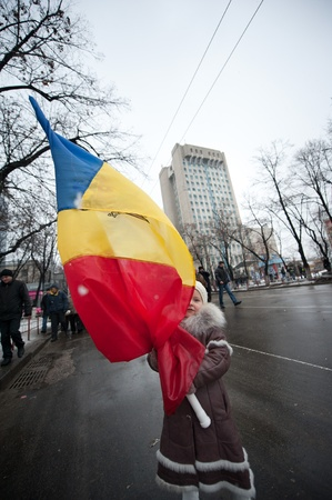 against the current: Holding a Moldovan flag, young Nastya marches in Chisinau, Moldova, at a protest against current administration.